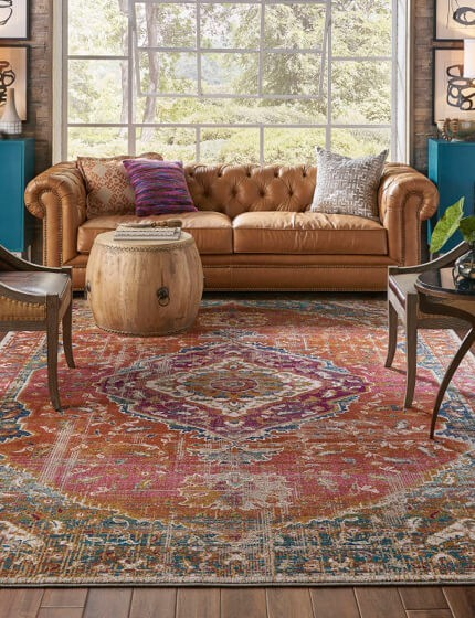 Beautiful area rug elegantly anchor a room's furniture | Family Floors